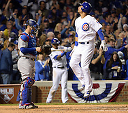 CHICAGO, IL - OCTOBER 22: Willson Contreras #40 of the Chicago Cubs jumps on home plate after hitting a solo home run in the fourth inning during Game 6 of the NLCS against the Los Angeles Dodgers at Wrigley Field on Saturday, October 22, 2016 in Chicago, Illinois. (Photo by Ron Vesely/MLB Photos via Getty Images)   *** Local Caption *** Willson Contreras