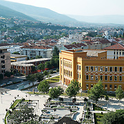 MOSTAR, BOSNIA AND HERZEGOVINA - JUNE 28:  A general view of Spanish Square with a newly refurbished building and an old derelict one from the time of 1993 war seen on June 28, 2013 in Mostar, Bosnia and Herzegovina. The Siege of Mostar reached its peak and more cruent time during 1993. Initially, it involved the Croatian Defence Council (HVO) and the 4th Corps of the ARBiH fighting against the Yugoslav People's Army (JNA) later Croats and Muslim Bosnian began to fight amongst each other, it ended with Bosnia and Herzegovina declaring independence from Yugoslavia.  (Photo by Marco Secchi/Getty Images)