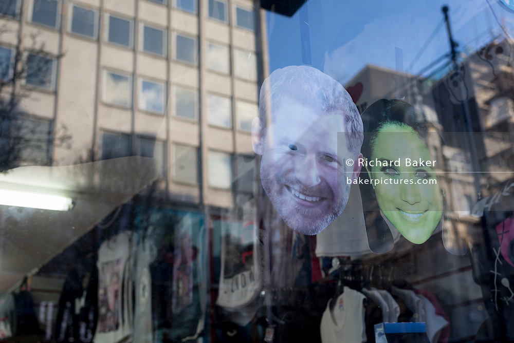 British royal family merchanidise and tourism souvenir masks which show the faces of the Duke and Duchess of Sussex (Prince Harry and Meghan Markle) on their wedding day, on display in the window of trinket shop in Oxford Street, on 15th January 2020, in London, England.