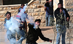November 17, 2018 - West Bank, Palestinian Territory - Palestinian protesters clash with Israeli forces after prevent Palestinian farmers to reach to their lands and planting olive trees, in the West Bank village of Urif, near Nablus. (Credit Image: © Shadi Jarar'Ah/APA Images via ZUMA Wire)