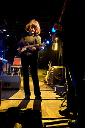 17 December, 05. Tipitina's, New Orleans, Louisiana.<br />  Arlo Guthrie and friends Riding on the city of New Orleans tour benefiting Musicares Hurricane relief 2005 sponsored by Amtrak. One of the Burns Sisters waits to go on stage.<br /> Photo; ©Charlie Varley/varleypix.com