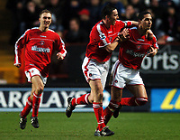Photo: Javier Garcia/Back Page Images<br />Charlton Athletic v Arsenal, FA Barclays Premiership, The Valley 01/01/2005<br />Talal El Karkouri is congratulated by Matt Holland after his goal