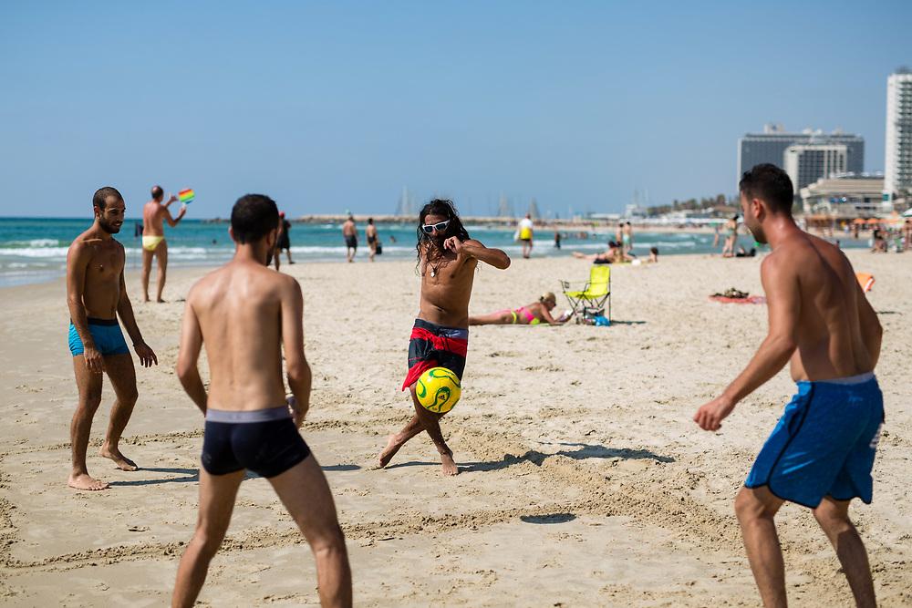 Israelis play soccer at Frishman Beach, in Tel Aviv, Israel, on July 21, 2015.