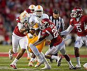 Nov 12, 2011; Fayetteville, AR, USA;  Tennessee Volunteers wide receiver Da'Rick Rogers (21) is brought down by linebacker Alonzo Highsmith (45) and cornerback Greg Gatson (28) and other defenders during a game at Donald W. Reynolds Razorback Stadium. Arkansas defeated Tennessee 49-7. Mandatory Credit: Beth Hall-US PRESSWIRE