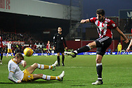 Yoann Barbet of Brentford (R) takes a shot at goal. EFL Skybet football league championship match, Brentford v Sheffield Wednesday at Griffin Park in London on Saturday 30th December 2017.<br /> pic by Steffan Bowen, Andrew Orchard sports photography.