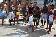 Young girl dancing passinho to funk Carioca, Baile funk with a group of young men guys on a rooftop, Vila Valquiere, West Zone Zona Oueste, Rio de Janeiro