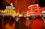 Tourists walk the Fremont Street Experience, April 20, 2006. Fremont Street dates back to 1905, when Las Vegas itself was founded. In 1931 the Northern Club received one of the first 6 gambling licenses issued in Nevada and the first one for Fremont Street.