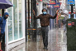 © Licensed to London News Pictures. 28/07/2021. London, UK. A man is caught during a torrential downpour in north London. According to The Met Office, wet weather is expected in the capital for this week. Photo credit: Dinendra Haria/LNP