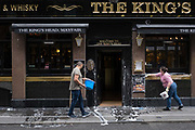 With a further 89 UK covid victims in the last 24hrs, bringing the total victims to 43,995 during the Coronavirus pandemic, pubs, restaurants and hairdressers will be able to reopen on 4th July, providing they adhere to COVID Secure guidelines. Two employees use buckets of soapy water to wash the exterior of the Kings Head pub in Mayfair, on 2nd July 2020, in London, England.