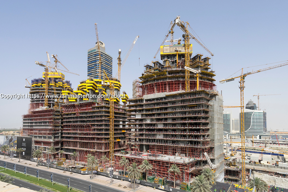 Three new luxury apartment towers under construction in Downtown district of Dubai United Arab Emirates