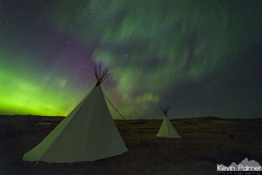 With both clear skies and a geomagnetic storm in the forecast, I headed north of the border to Saskatchewan. Grasslands National Park is a long ways from anywhere. During the day the landscape seems stark and desolate, especially after a very dry summer. But the real beauty of this park comes after sunset. It is one of the darkest places on the continent. With no sources of light pollution at all, the stars appear the same as they did to the Plains Indians hundreds of years ago. The aurora was already bright and colorful earlier in the evening. But at midnight after the moon set, the northern lights went insane. I've never seen such rapid motion before. If you could imagine a campfire with the flames rising upward and flickering on and off, that's what it looked like. Except instead of orange, it was green, and instead of it being confined to a fire ring, it filled the entire sky. I don't think any camera could fully capture it, it just has to be experienced.