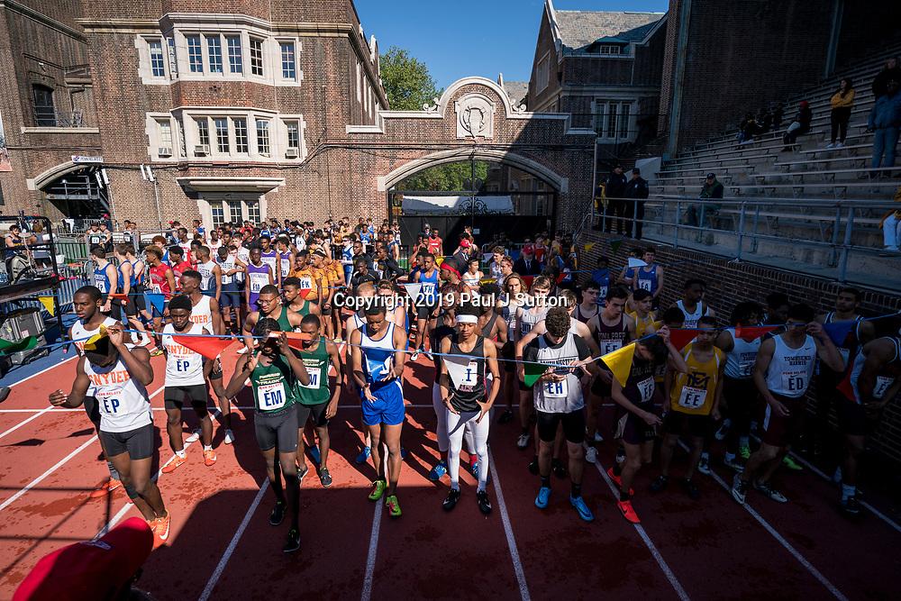High School boys 4x400 runners waitng in the penn area at the 2019 Penn Relay.