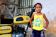 Girl and motorcycle in Gibara, Holguin, Cuba.