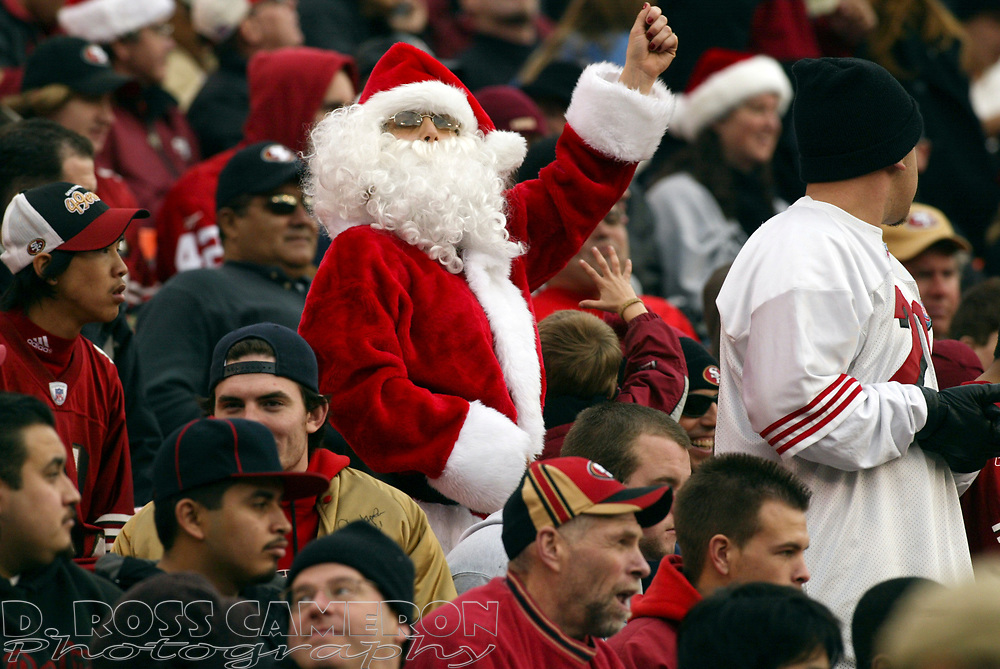 An unidentified fan dressed as Santa Claus watches the Arizona Cardinals and San Francisco 49ers play an NFL football game, Sunday, Dec. 24, 2006 at Candlestick Park in San Francisco. The Cardinals won, 26-20. (D. Ross Cameron/The Oakland Tribune)