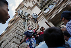 © Gabriel Szabo - Licensed to London News Pictures. MIgrants outside Keleti station are fighting to decide, if they should stay put  outside Keleti in Budapest or if they should walk to Austria  on 4th of September, 2015