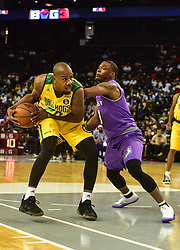 July 6, 2018 - Oakland, California, United States - Ball Hogs Andre Owens (20) handles the ball as Ghost Ballers Marcus Banks (3) defends during Week 3 of the BIG3 3-on-3 basketball league at Oracle Arena. (Credit Image: © Debby Wong via ZUMA Wire)