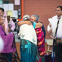 Phyllis Smith, center, a breast cancer survivor gives encouragement to others and shares her story of survival at a Cancer Awareness Pow Wow, Saturday, June 8 at Gallup High School.