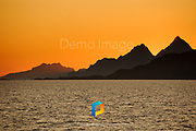 Mountains silhouetted at sunset in Lofoten, Norway.