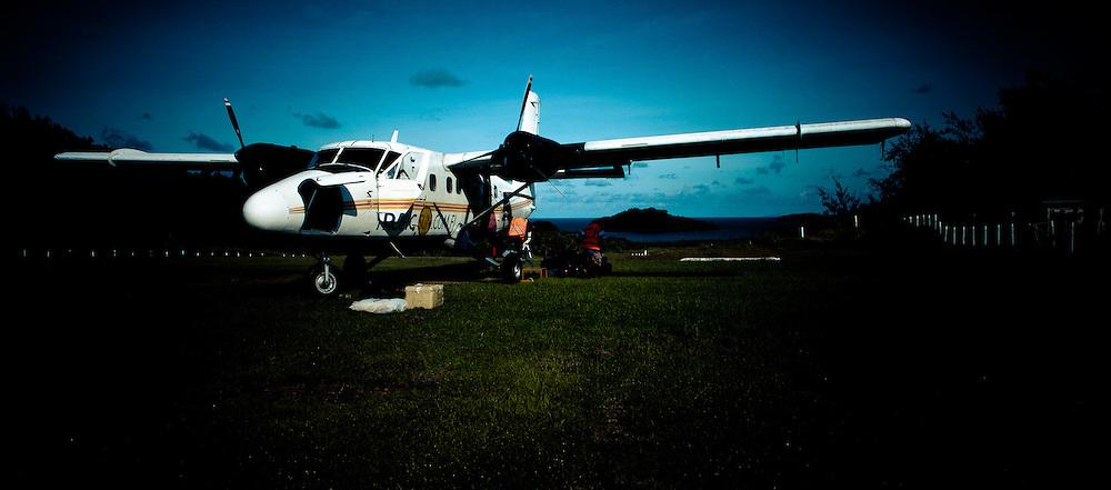 Biplane on Grass Runway in Fiji