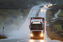 © Licensed to London News Pictures. 26/01/2016. Appleby UK. Drivers on the A66 near Appleby struggled with torrential rain & high cross winds this morning as Storm Jonas arrived in Cumbria. Photo credit: Andrew McCaren/LNP
