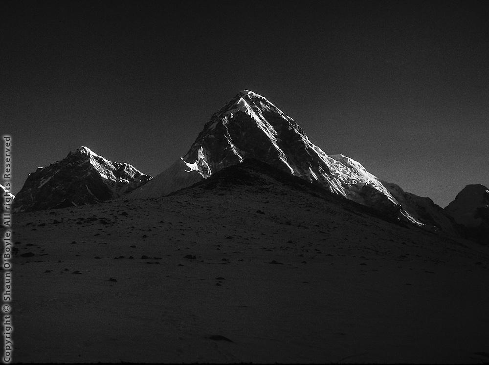 Pumori, with Kala Patthar in the foreground. Nepal Himalaya.