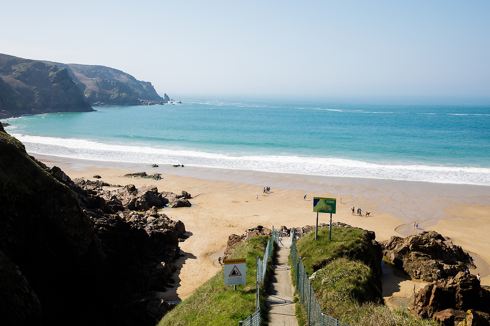 Walkway down to Plemont beach with the view straight out to sea on a sunny summers day in Jersey, CI