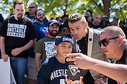 Corey Graves takes a photo with a young fan outside WrestleMania on April 3, 2016 in Arlington, Texas.