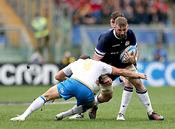 Scotland's John Barclay is tackled by Italy's Marcello Violi (left) during the NatWest 6 Nations match at the Stadio Olimpico, Rome.