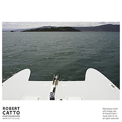 Wellington's Dominion Post / East By West ferry approaches Somes Island in Lambton Harbour, on New Zealand's North Island.<br />