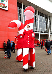 Festively dressed stilt walkers greet fans outside the stadium during the Premier League match at St Mary's, Southampton.