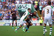 Joseph Ralls of Yeovil Town and Danny Williams of Reading during the Skybet championship match, Yeovil Town v Reading at Huish Park in Yeovil on Saturday 31st August 2013. <br /> Picture by Sophie Elbourn, Andrew Orchard sports photography,