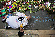 CHARLOTTESVILLE, USA - August 16: Douglas Brown from Newport News kisses the ground at a memorial for Heather Heyer and the other victims at the intersection where James Alex Fields Jr., a White Supremacist, drove his car into a crowd of counter-protestors, killing Heyer and wounding 19 others last Saturday, in Charlottesville, Va., USA on August 16, 2017.
