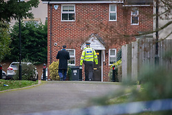 © Licensed to London News Pictures. 05/01/2020. Slough, UK. A Police officer escorts a resident inside a cordon in Slough at a suspected murder scene, local residents reported that a teenage boy was stabbed on the evening of Saturday 4th January and rushed to Wexham Park hospital where he later died. Photo credit: Peter Manning/LNP