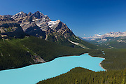Bow Mountain towers over Peyto Lake, located in Banff National Park, Alberta, Canada. Peyto Lake is fed by glaciers and its unique turquoise color comes the silt deposited by them.