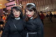 Two young Japanese women dressed as nuns during the Halloween celebrations in Shibuya, Tokyo, Japan. Wednesday October 31st 2018 .  Halloween has grown massively popular  in Japan over the last few yers. Primarily an event for young adults who use it as a chance to dress up in inventive costumes and spend the night partying . In recent years the misbehaviour of some revellers has caused a heavier police presence on the street and  a push back from the Japanese society, and media  who see no need for nor benefits to this western cultural import.