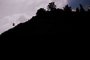 Threatening storm clouds and a black silhouette of a vineyard and hilltop.  Domaine Pierre Gaillard, Malleval, Ardeche, ardèche, France, Europe