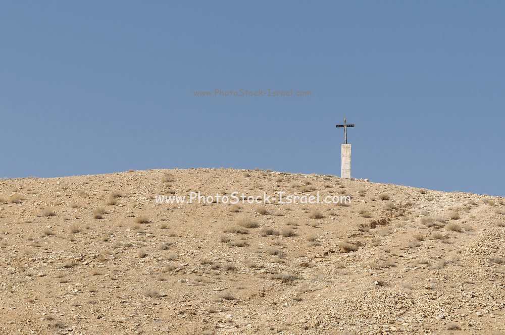 A crucifix in the Judaean Desert, Israel photographed near the St. George Greek Orthodox Monastery, a monastery located in the Judean Desert Wadi Qelt, in the eastern West Bank