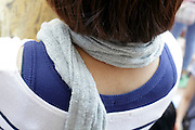 close up view of back of woman wearing a scarf
