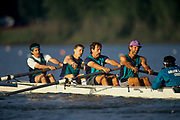 Four with coxwain rowing team competing.