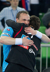 Peter Pucelj and Matevz Skok of Slovenia celebrate after winning the handball match between National teams of Slovenia and Poland of Qualification Group 3 for Men's EURO 2012, on March 9, 2011 in Arena Stozice, Ljubljana, Slovenia. Slovenia defeated Poland 30-28. (Photo By Vid Ponikvar / Sportida.com)