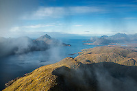 Clearing clouds conceal view over Nappstraumen and mountain landscape from summit of Skottind, Vestvågøy, Lofoten Islands, Norway