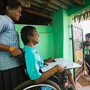 CAPTION: Shesh Naik has multiple disabilities, including cerebral palsy. His only mobility comes through wheelchair use, and he's totally dependent on family members to wheel him around. He still needs a ramp to be constructed, so that they will be able to get him into and out of the family home. LOCATION: Amchawadi (village), Haradanahalli (hobli), Chamrajnagar (district), Karnataka (state), India. INDIVIDUAL(S) PHOTOGRAPHED: From left to right: Padma, Shesh Naik, Raghu and Latha.