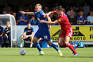 AFC Wimbledon striker Joe Pigott (39) battles for possession with Accrington Stanley defender Ross Sykes (5) during the EFL Sky Bet League 1 match between AFC Wimbledon and Accrington Stanley at the Cherry Red Records Stadium, Kingston, England on 17 August 2019.
