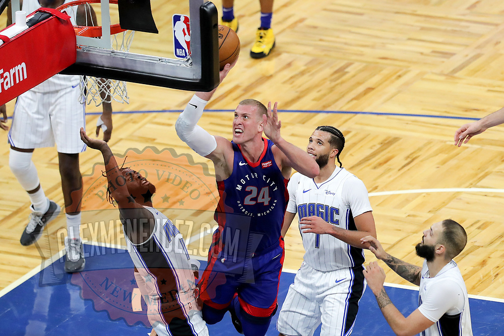 ORLANDO, FL - FEBRUARY 23:  Mason Plumlee #24 of the Detroit Pistons attempts a shot over James Ennis III #11 of the Orlando Magic, Michael Carter-Williams #7 of the Orlando Magic and Evan Fournier #10 of the Orlando Magic during the second half at Amway Center on February 23, 2021 in Orlando, Florida. NOTE TO USER: User expressly acknowledges and agrees that, by downloading and or using this photograph, User is consenting to the terms and conditions of the Getty Images License Agreement. (Photo by Alex Menendez/Getty Images)*** Local Caption *** Mason Plumlee; James Ennis III; Michael Carter-Williams; Evan Fournier