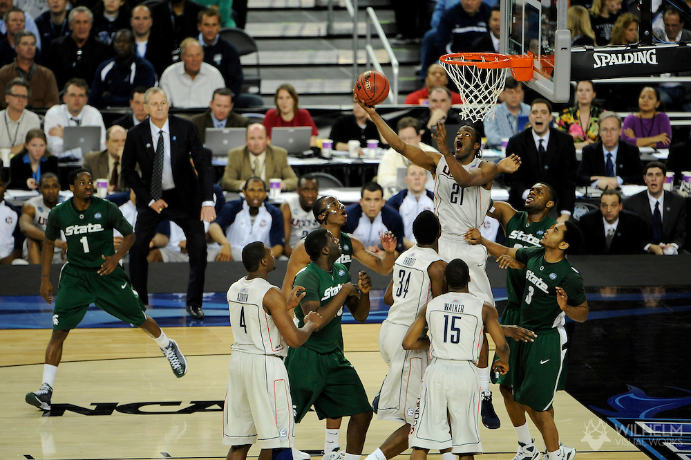 4 APR 2009: Stanley Robinson (21) of the University of Connecticut takes on Chris Allen (3) and Korie Lucious (34) of  Michigan State University during the semifinal game of the 2009 NCAA Final Four Division I Men's Basketball championships held at Ford Field in Detroit, MI.  Michigan State defeated Connecticut 82-73 to advance to the championship game.  © Brett Wilhelm
