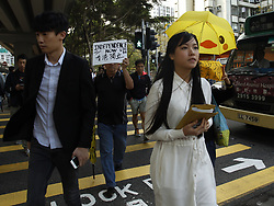 April 28, 2017 - Hong Kong, CHINA - Disqualified lawmakers of pro-independence political party YOUNGSPIRATION, Yau-Wai-ching ( R ) and Baggio Leung ( L ) cross the zebra after leaving the court today charged with unlawful assembly and unlawful forced entry at LEGICO last November. 2017, Apr-28. Hong Kong. ZUMA/Liau Chung Ren (Credit Image: © Liau Chung Ren via ZUMA Wire)
