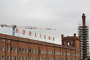 The former Horlicks factory site is pictured on 9 September 2020 in Slough, United Kingdom. The site is currently being redeveloped as Horlicks Quarter by Berkeley Homes to create five apartment blocks containing up to 1,300 new homes whilst restoring the factory building, its 47m chimney and clock tower.