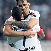 Besiktas's Hugo ALMEIDA (B) celebrate his goal with team mate during their Turkish Superleague Derby match Besiktas between Fenerbahce at the Inonu Stadium at Dolmabahce in Istanbul Turkey on Thursday, 207 October 2011. Photo by TURKPIX