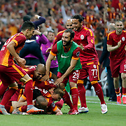 Galatasaray's Wesley Sneijder celebrate his goal with team mate during their Turkish Super League derby match Galatasaray between Besiktas at the AliSamiYen Spor Kompleksi TT Arena at Seyrantepe in Istanbul Turkey on Sunday, 24 May 2015. Photo by Aykut AKICI/TURKPIX