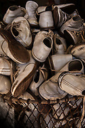 Bin of used white childrens shoes in secondhand store on 28th February 2020 in Breaux Bridge, Louisianna, United States.